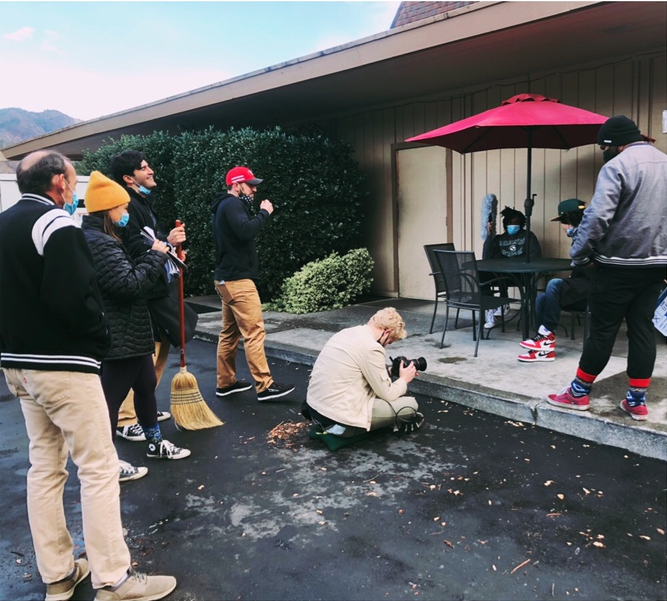 Cast and crew filming a scene